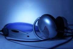 Head-phones. In blue light Royalty Free Stock Photo