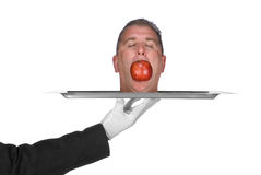 Head on a platter. A head is served on a platter by a waiter. Image was shot for use as any trouble inference such as business and crime Stock Image