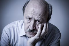 Head portrait of senior mature old man on his 60s looking sad an stock photos
