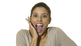 Head portrait of young happy and excited hispanic woman 30s in surprise and astonished face expression eyes and mouth wide open is royalty free stock photo