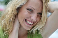 Head portrait of young smiling woman outdoors Royalty Free Stock Photo