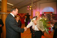The head of the Priozersk district Sergey doroshuk presenting flowers from the admirers of Belarusian singer Alexander Solodukha. Royalty Free Stock Images