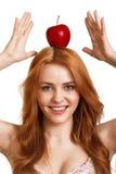 head rött le kvinnabarn för äpple Royaltyfria Bilder