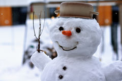 Snowman. A real snowman. Detail of a head with a carrot and a pot Stock Images