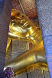 Head of the Reclining Buddha in Wat Pho. Head of the golden Reclining Buddha in Wat Pho, Bangkok, Thailand royalty free stock photos