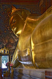 Head of the Reclining Buddha in Wat Pho. Head of the golden Reclining Buddha in Wat Pho, Bangkok, Thailand stock photo