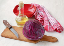 A head of red cabbage and a bottle of oil Stock Images
