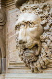 Head of roaring lion. In medieval sculpture Royalty Free Stock Photography