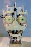 Head of a robot with funny green eyes and a funny expression Stock Photos