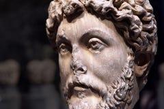 Head of Roman emperor Marcus Aurelius, detail of an ancient marble statue stock photo