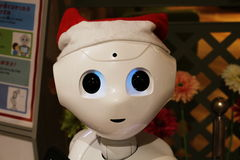 Head of a santa-hat clad Pepper robot in a Japanese shopping Mall Stock Image