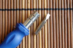 Head for screwdriver bit with turn-screw on wooden background, Tools collection Royalty Free Stock Photos
