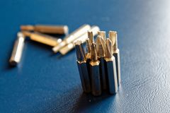 Head for screwdriver bits on blue background, Tools collection turn-screw.  Royalty Free Stock Photo