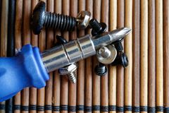 Head for screwdriver bits on wooden background, Tools collection turn-screw.  Royalty Free Stock Photography