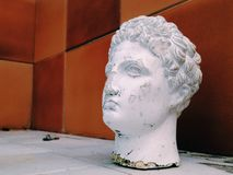 Head sculpture. Chipped antique sculpture of a human head Royalty Free Stock Images