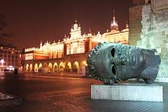 Head sculpture Eros Bendato on Market Square, Krakow, Poland Royalty Free Stock Images