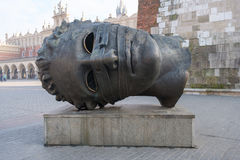 Head sculpture Eros Bendato on Market Square by polish artist Igor Mitoraj Stock Photography