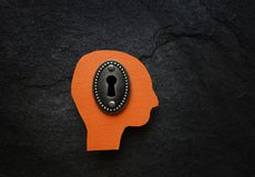 Head and lock. Head shape with a lock, on dark background Stock Photography