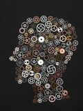 Head shape made out of little cogwheels. Stock Photography