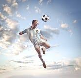 Head shot. Soccer player head shooting a football royalty free stock photo