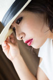 Head shot of asia woman with hat, beauty concept Royalty Free Stock Photo