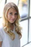 Head Shot of a Beautiful Blond Woman with Brown Eyes Royalty Free Stock Images