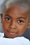 Head shot of black boy. Young black child looking at camera in portrait style Stock Image