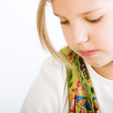 Head shot of a blond young girl looking down stock photography