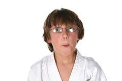Head shot of boy in martial arts gi. Funny face boy in martial arts gi top and glasses Stock Photo