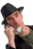Head and shoulders shot of caucasian male wearing a hat. A head shot of a Caucasian male wearing a pin striped hat and talking on a telephone. He appears to be a Royalty Free Stock Image