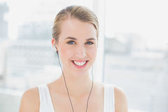 Head shot of cheerful sporty woman listening to music Royalty Free Stock Photos