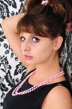 Head shot of coleen. Woman leaning against a wall facing the camera Stock Images