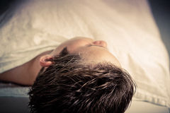 Head Shot of a Dead Boy Lying in the Morgue Royalty Free Stock Image