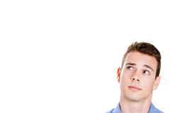 Head shot of handsome man daydreaming, looking up and to side Royalty Free Stock Image