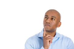 Head shot of handsome man daydreaming, looking up and to side Stock Images