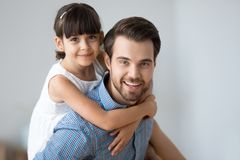 Head shot portrait daughter and father indoors royalty free stock photos