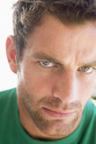 Head shot of man scowling stock images