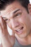 Head shot of man scowling Stock Image