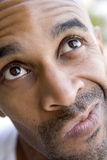 Head shot of man thinking Stock Image