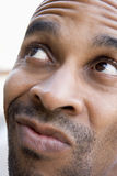 Head shot of man thinking Stock Images