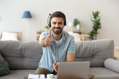 Head shot portrait happy smiling man in headset show thumbs up royalty free stock images