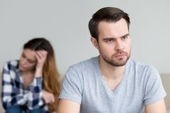 Head shot portrait sad, frustrated, desperate young man royalty free stock image