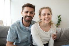 Head shot portrait of smiling couple, look at camera, making video call royalty free stock photos