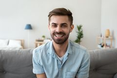 Head shot portrait of smiling man looking at camera, video call stock images