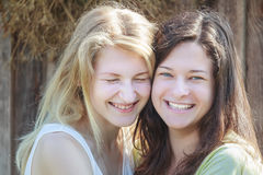 Head shot portrait of two best friends laughing and hugging during summer vacations Stock Photography