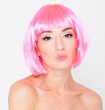 Head shot of sexy young woman in pink wig on white background Stock Photos