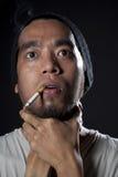 Head shot of a sick smoker Royalty Free Stock Photos
