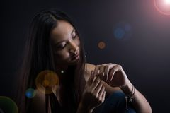 Broken heart lonely girl can cry, smoke Fog on dark Background. Head shot only Tan Skin Asian Woman black straight hair dark Background, Abstract high low Stock Image