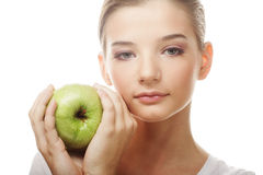 Head shot of woman holding apple Royalty Free Stock Image