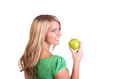 Head shot of woman holding apple against white background Stock Photos